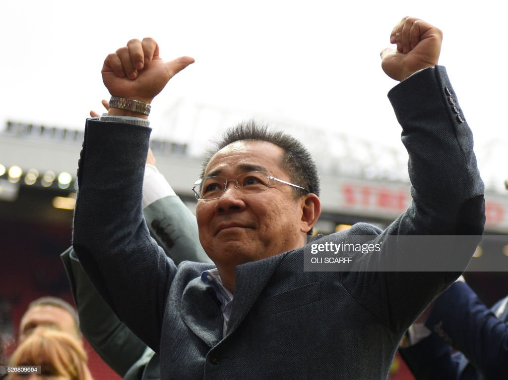 Leicester City's Thai chairman Vichai Srivaddhanaprabha gives a thumbs up to fans after the English Premier League football match between Manchester United and Leicester City at Old Trafford in Manchester, north west England, on May 1, 2016. / AFP / OLI SCARFF / RESTRICTED TO EDITORIAL USE. No use with unauthorized audio, video, data, fixture lists, club/league logos or 'live' services. Online in-match use limited to 75 images, no video emulation. No use in betting, games or single club/league/player publications. /
