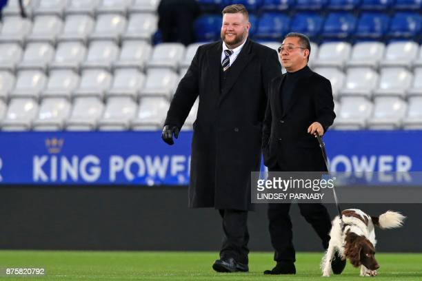 Leicester City's Thai chairman Vichai Srivaddhanaprabha walks out to board his helicopter after the English Premier League football match between...