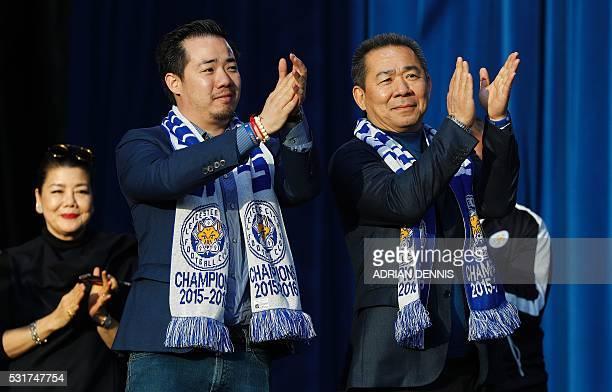 Leicester City's Thai owner and chairman Vichai Srivaddhanaprabha and his son Aiyawatt Srivaddhanaprabha applaud the Leicester City football team...
