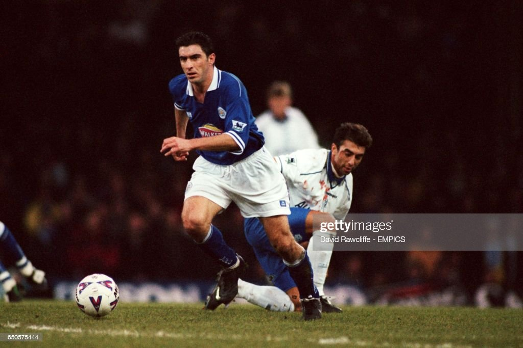 Leicester City's Theo Zagorakis (left) gets away from Chelsea's Roberto Di Matteo
