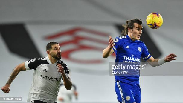 Leicester City's Turkish defender Caglar Soyuncu heads the ball as Fulham's Serbian striker Aleksandar Mitrovic closes in during the English Premier...