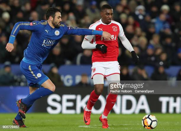 Leicester City's Vicente Iborra and Fleetwood Town's Amari'i Bell during The Emirates FA Cup Third Round Replay match between Leicester City and...