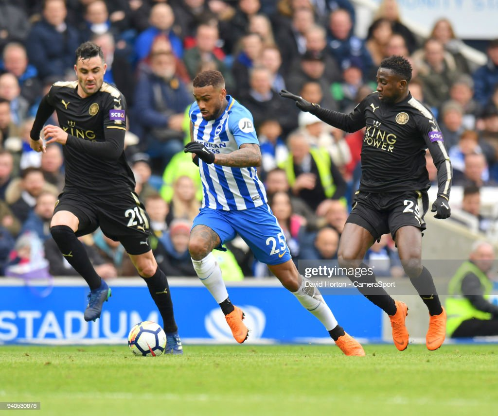Leicester City's Vicente Iborra & ilfred Ndidi battles with Brighton & Hove Albion's Jurgen Locadia (centre) during the Premier League match between Brighton and Hove Albion and Leicester City at Amex Stadium on March 31, 2018 in Brighton, England.