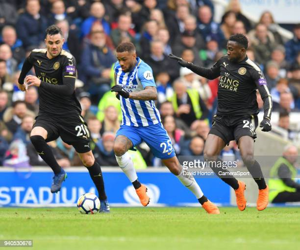 Leicester City's Vicente Iborra ilfred Ndidi battles with Brighton Hove Albion's Jurgen Locadia during the Premier League match between Brighton and...
