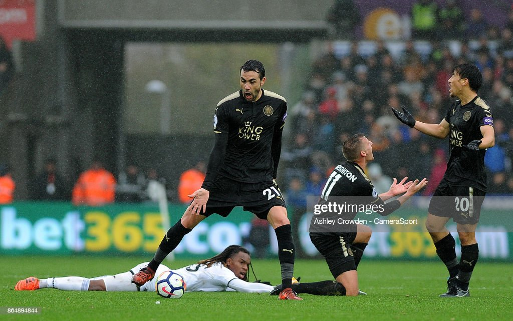 Leicester City's Vicente Iborra, Marc Albrighton and Shinji Okazaki react to a foul against Swansea City's Renato Sanches during the Premier League match between Swansea City and Leicester City at Liberty Stadium on October 21, 2017 in Swansea, Wales.