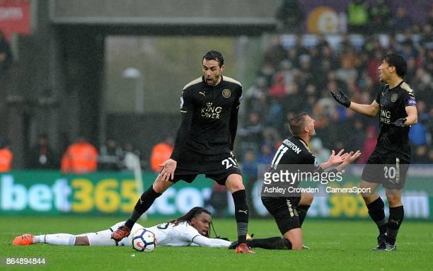 Leicester City's Vicente Iborra Marc Albrighton and Shinji Okazaki react to a foul against Swansea City's Renato Sanches during the Premier League...