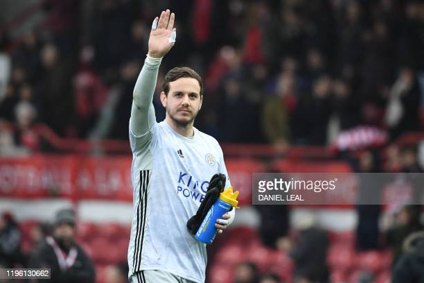 Leicester City's Welsh goalkeeper Danny Ward gestures to supporters as he leaves after the English FA Cup fourth round football match between...