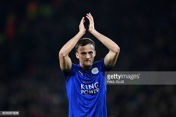 Leicester City's Welsh midfielder Andy King applauds the fans following during the UEFA Champions League group G football match between Leicester...