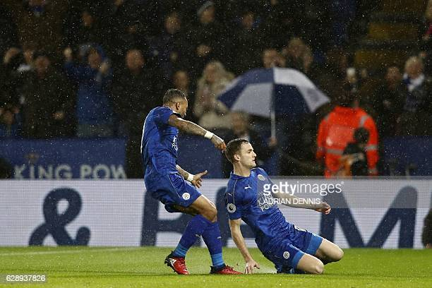 Leicester City's Welsh midfielder Andy King celebrates after scoring their second goal during the English Premier League football match between...