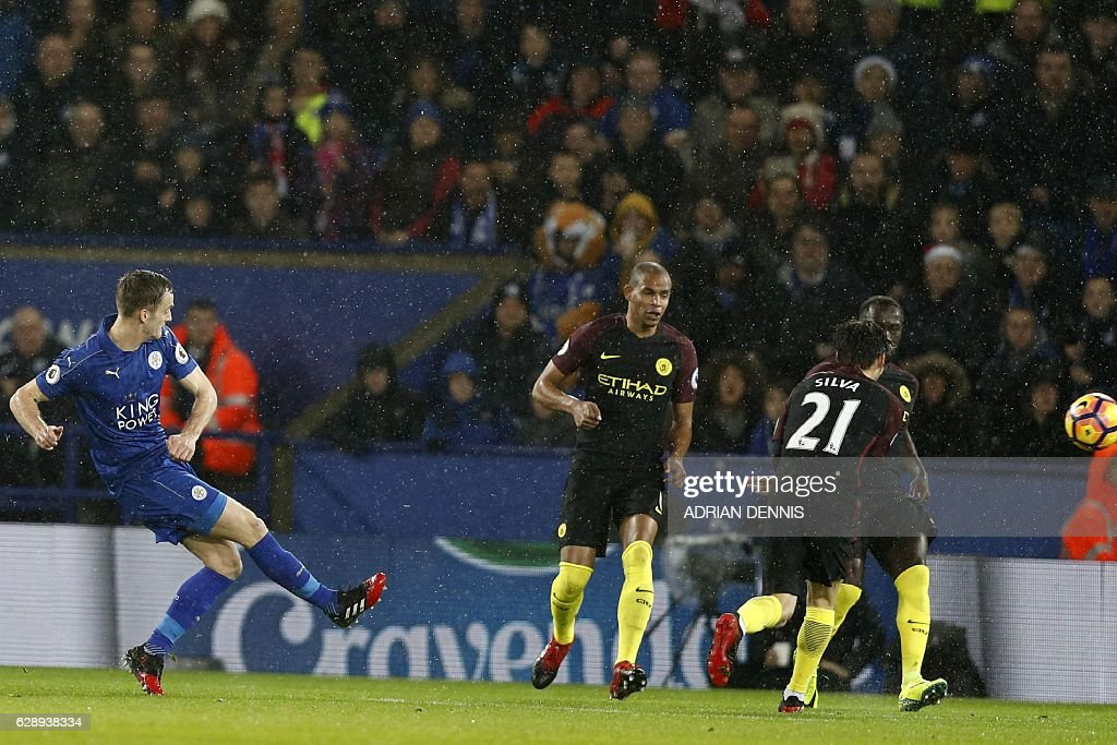 Leicester City's Welsh midfielder Andy King (L) shoots to score their second goal during the English Premier League football match between Leicester City and Manchester City at King Power Stadium in Leicester, central England on December 10, 2016. / AFP / Adrian DENNIS / RESTRICTED TO EDITORIAL USE. No use with unauthorized audio, video, data, fixture lists, club/league logos or 'live' services. Online in-match use limited to 75 images, no video emulation. No use in betting, games or single club/league/player publications. /