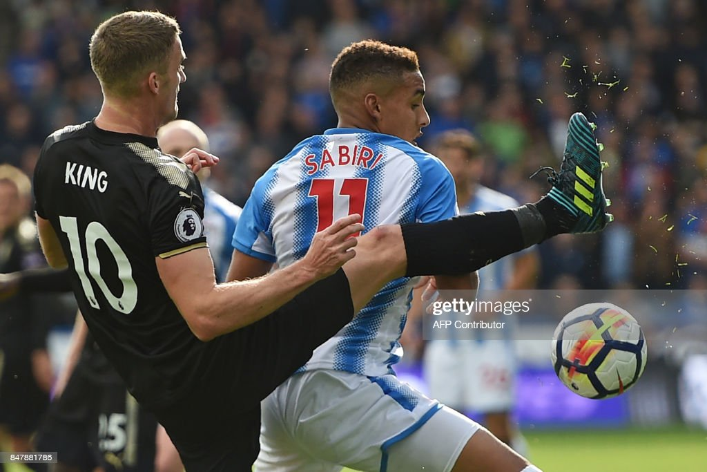 Leicester City's Welsh midfielder Andy King (L) vies with Huddersfield Town's Morroccan midfielder Abdelhamid Sabiri (R) during the English Premier League football match between Huddersfield Town and Leicester City at the John Smith's stadium in Huddersfield, northern England on September 16, 2017. / AFP PHOTO / Oli SCARFF / RESTRICTED TO EDITORIAL USE. No use with unauthorized audio, video, data, fixture lists, club/league logos or 'live' services. Online in-match use limited to 75 images, no video emulation. No use in betting, games or single club/league/player publications. /