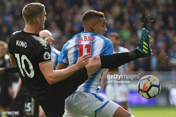 Leicester City's Welsh midfielder Andy King vies with Huddersfield Town's Morroccan midfielder Abdelhamid Sabiri during the English Premier League...