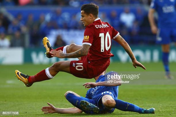 Leicester City's Welsh midfielder Andy King vies with Liverpool's Brazilian midfielder Philippe Coutinho during the English Premier League football...