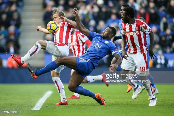 Leicester City's Wes Morgan competing with Stoke City's Xherdan Shaqiri and Mame Biram Diouf during the Premier League match between Leicester City...