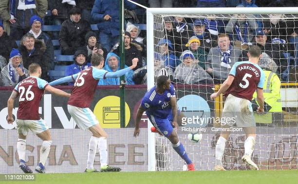 Leicester City's Wes Morgan scores his side's second goal past Thomas Heaton despite the attentions of James Tarkowski during the Premier League...