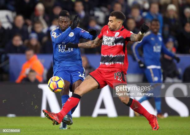 Leicester City's Wilfred Ndidi and Huddersfield Town's Danny Williams battle for the ball during the Premier League match at the King Power Stadium...
