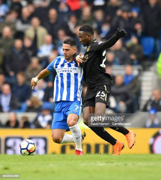 Leicester City's Wilfred Ndidi battles with Brighton Hove Albion's Beram Kayal during the Premier League match between Brighton and Hove Albion and...