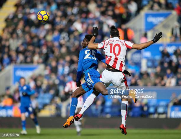 Leicester City's Wilfred Ndidi competing in the air with Stoke City's Eric Maxim ChoupoMoting during the Premier League match between Leicester City...