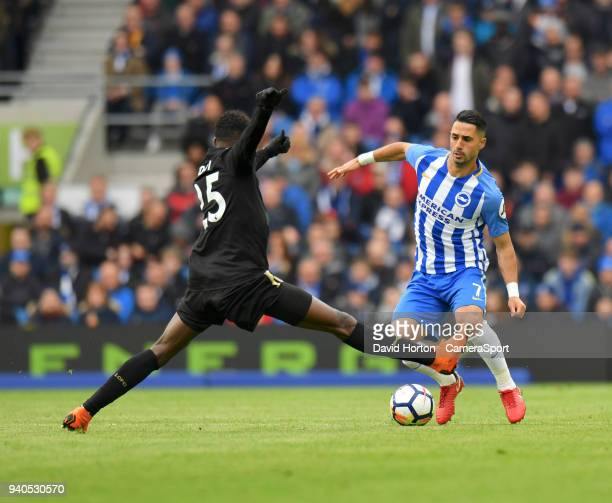 Leicester City's Wilfred Ndidi vies for possession with Brighton Hove Albion's Beram Kayal during the Premier League match between Brighton and Hove...