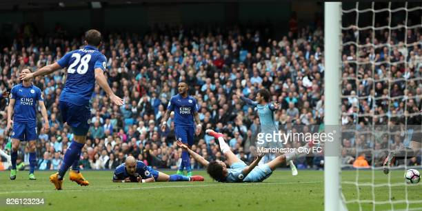Leicester City's Yohan Benalouane challenges Manchester City's Leroy Sane resulting in a penaty