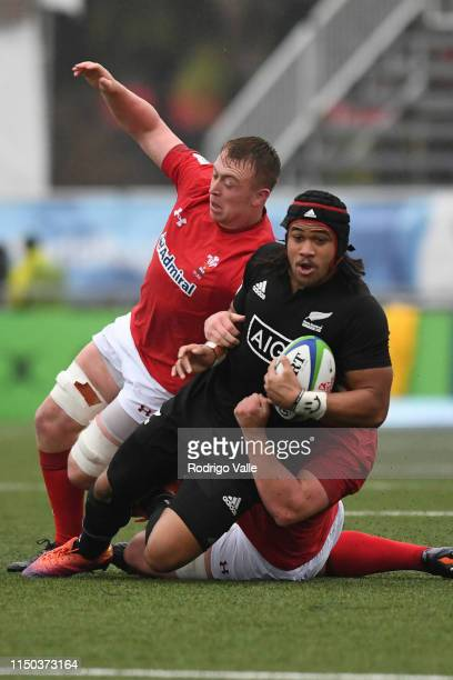 Leicester Fainga anuku of New Zealand U20 is tackled by Ben Warren of Wales U20 during a 5th place Semi Final match New Zealand U20 and Wales U20 as...