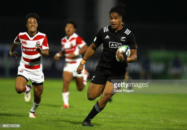 Leicester Faingaanuku of New Zealand breaks clear to score his third try during the World Rugby U20 Championship match between New Zealand and Japan...