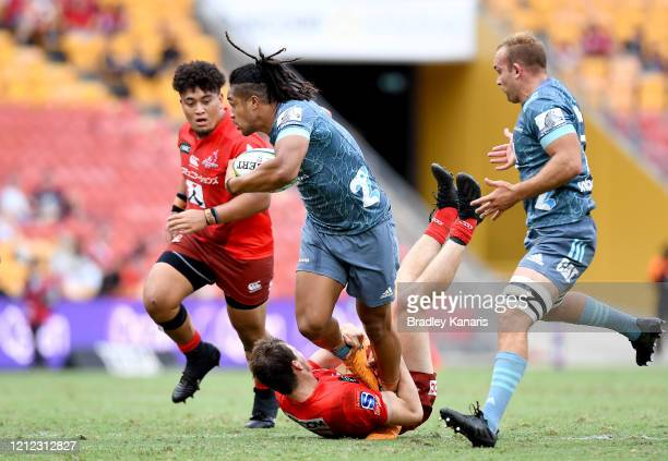 Leicester Fainga'anuku of the Crusaders attempts to break through the defence during the round seven Super Rugby match between the Sunwolves and the...