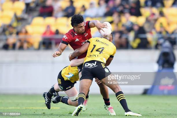 Leicester Fainga'anuku of the Crusaders offloads the ball during the round seven Super Rugby Aotearoa match between the Hurricanes and the Crusaders...