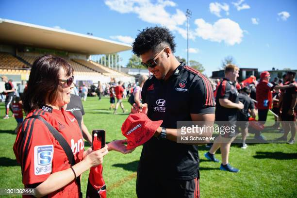 Leicester Fainga'anuku signs autographs during the Crusaders Super Rugby open fan day at Rugby Park on February 10, 2021 in Christchurch, New Zealand.