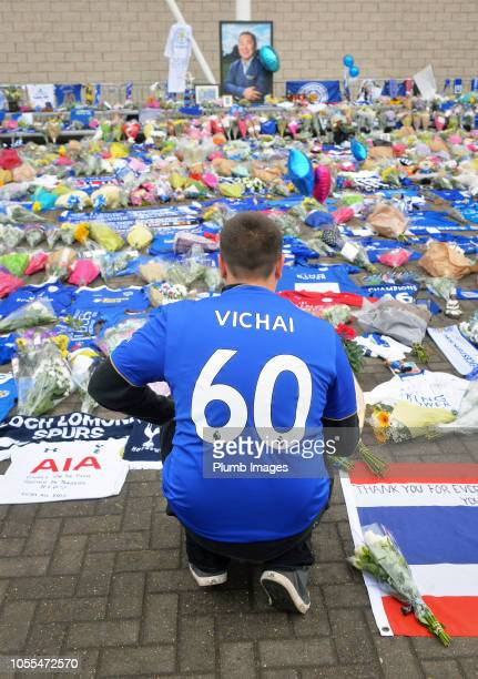 Leicester fan pays their respects after signing a book of condolence for Leicester City owner Vichai Srivaddhanaprabha is opened at King Power...