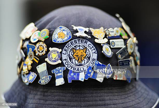 Leicester fan shows his badges prior to the Barclays Premier League match between Leicester City and Queens Park Rangers at The King Power Stadium on...