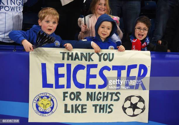 Leicester fans celebrate their team's 32 agg victory during the UEFA Champions League Round of 16 second leg match between Leicester City and Sevilla...
