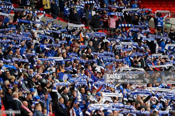 Leicester fans hold up their scarves in the crowd ahead of the English FA Cup final football match between Chelsea and Leicester City at Wembley...