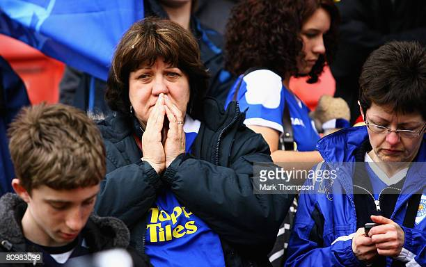 Leicester fans look dejected after todays draw sees them relegated to League One next season after the CocaCola Championship match between Stoke City...
