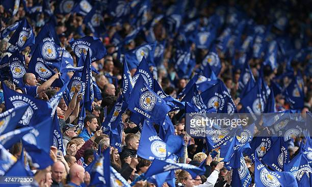 Leicester fans wave flags during the Premier League match between Leicester City and Queens Park Rangers at The King Power Stadium on May 24 2015 in...