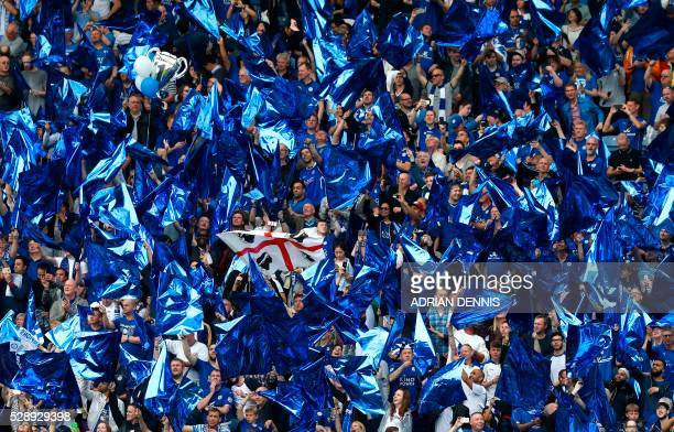 Leicester fans wave flags in the team colours before the English Premier League football match between Leicester City and Everton at King Power...