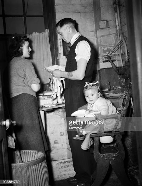 Leicester football team, FA Cup Finalists. Ted Jelly at home with wife and baby girl, 31st March 1949.