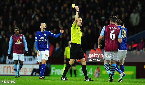 Leicester forward Jamie Vardy is yellow carded by referee Craig Pawson for a foul on Ashley Westwood during the Barclays Premier League match between...