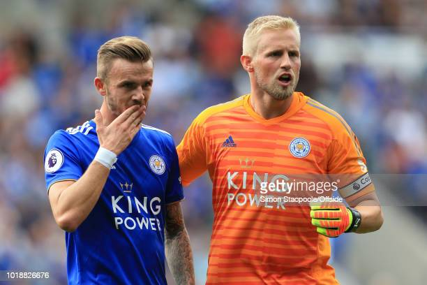 Leicester goalkeeper Kasper Schmeichel and James Maddison of Leicester talk tactics during the Premier League match between Leicester City and...