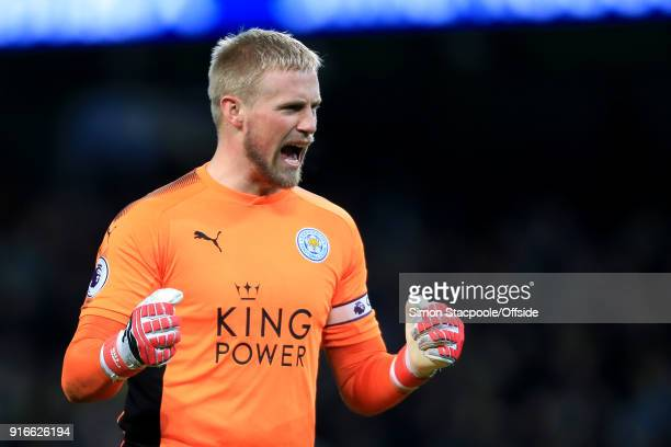 Leicester goalkeeper Kasper Schmeichel celebrates his side's 1st goal during the Premier League match between Manchester City and Leicester City at...