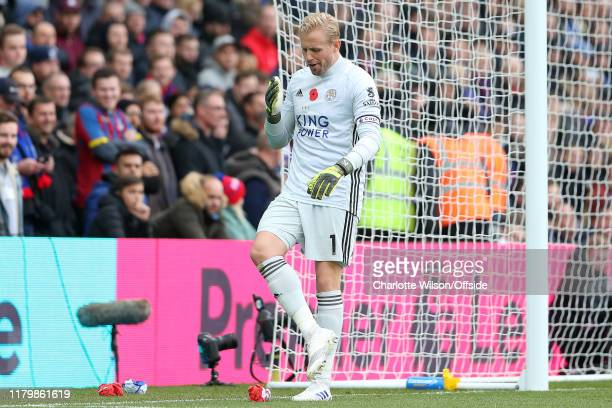 Leicester goalkeeper Kasper Schmeichel pretends to yawn as he reacts to Palace fans throwing balled up paper at him during the Premier League match...