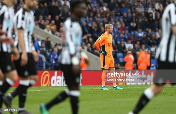 Leicester goalkeeper Kasper Schmeichel stands dejected after the second Newcastle goal during the Premier League match between Leicester City and...