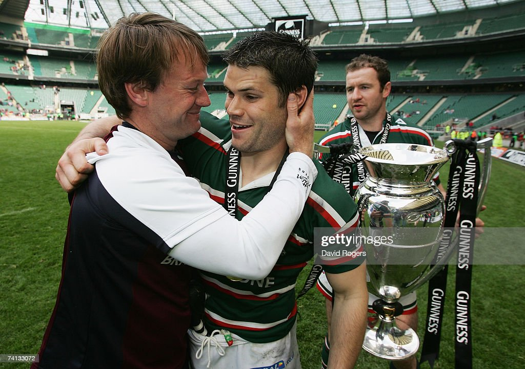 Leicester head coach, Pat Howard (L) hugs Dan Hipkiss (C) of Leicester following their team's victory during the Guinness Premiership final between Gloucester and Leicester Tigers at Twickenham on May 12, 2007 in London, England.