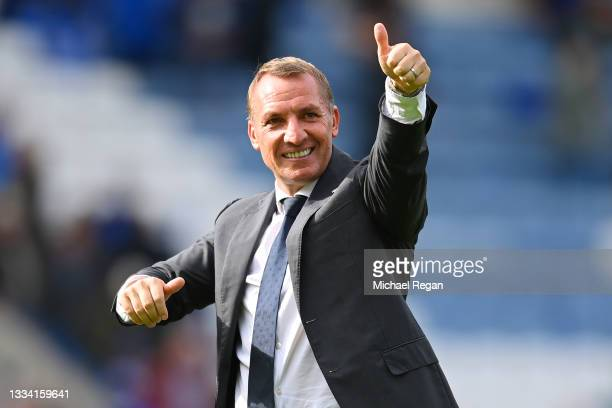 Leicester manager Brendan Rodgers celebrates with fans after the Premier League match between Leicester City and Wolverhampton Wanderers at The King...