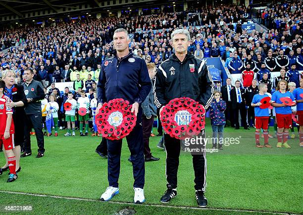 Leicester manager Nigel Pearson and West Bromwich Albion manager Alan Irvine observe a minute silence ahead of the Barclays Premier League match...
