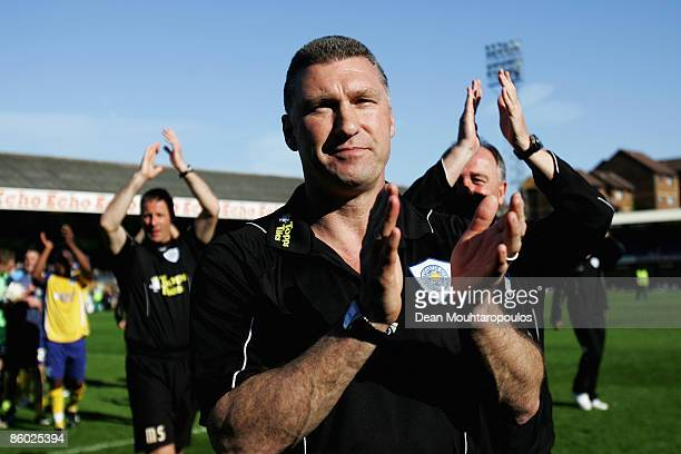 APRIL 18 Leicester Manager Nigel Pearson applaudes the fans after victory in the CocaCola Football League One match between Southend United and...