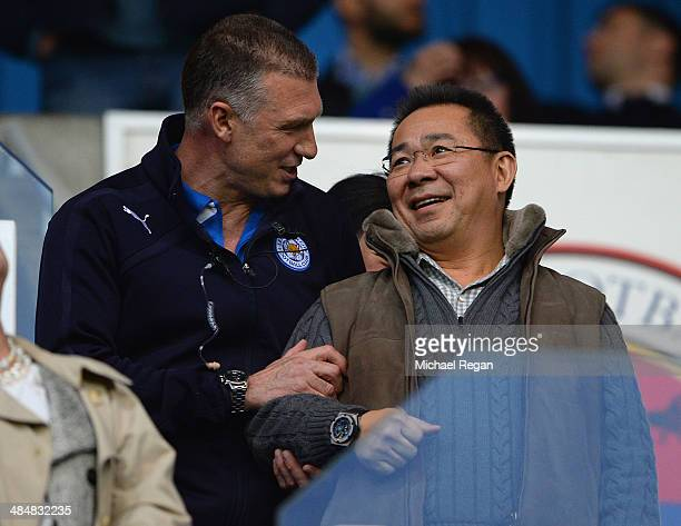 Leicester manager Nigel Pearson jokes with Leicester chairman Vichai Srivaddhanaprabha during the Sky Bet Championship match between Reading and...
