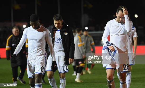 Leicester player Christian Fuchs and team mates leave the field after the FA Cup Third Round match between Newport County and Leicester City at...