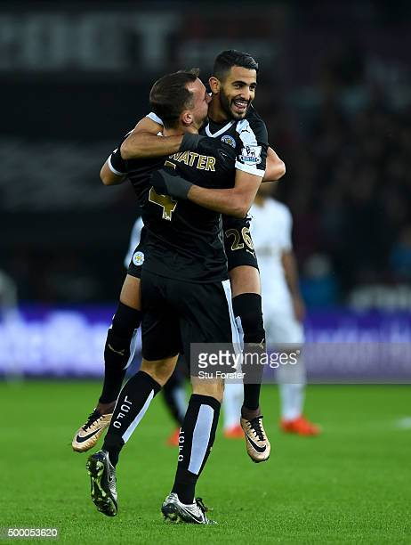 Leicester player Riyad Mahrez celebrates after scoring the first goal with Danny Drinkwater during the Barclays Premier League match between Swansea...