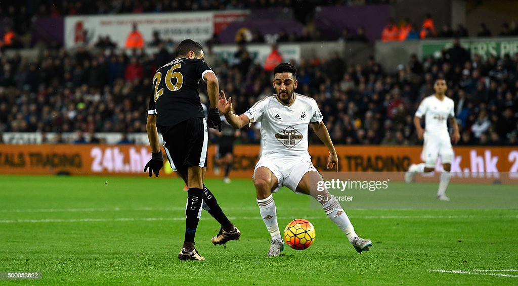 Leicester player Riyad Mahrez (l) scores the second goal during the Barclays Premier League match between Swansea City and Leicester City at Liberty Stadium on December 5, 2015 in Swansea, Wales.